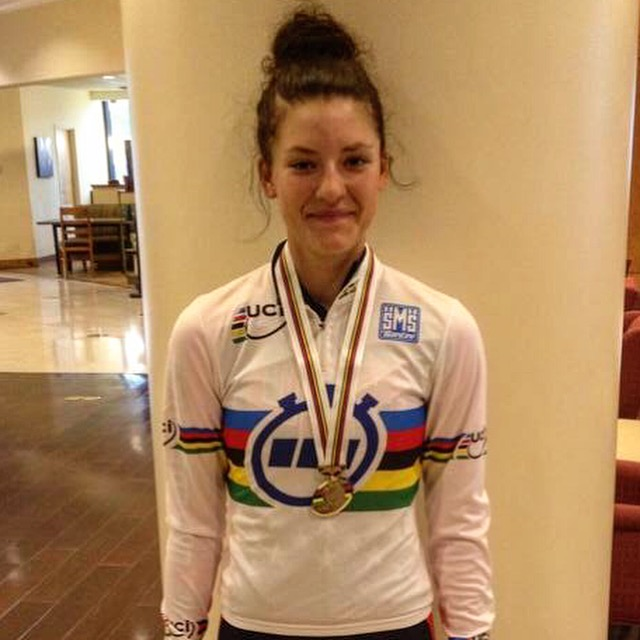 When You Are Champion of the World, You Get to Wear the Bands. Chloe Dygert with her new shirt and necklace.